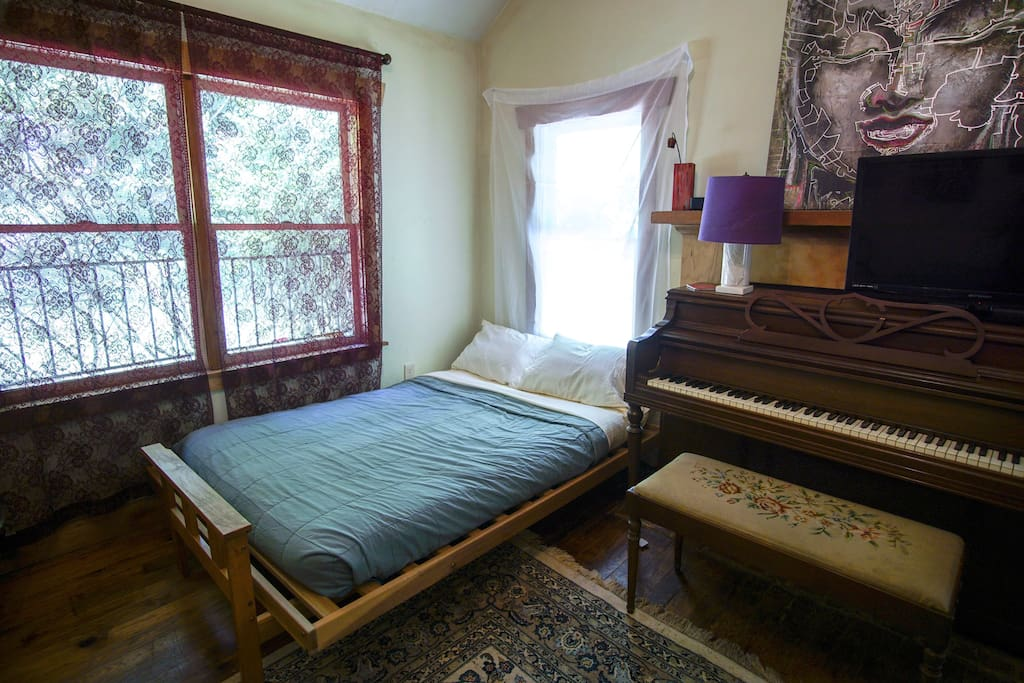 Great Room with natural lighting & piano. Brand new sheets, pillows & pillowcases on futon that sleeps a couple comfortably.