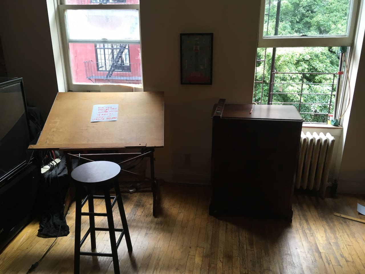 You get the drafting table overlooking the unlikely intersection of W 4/W 10 St.'s in the heart of historic Greenwich Village. Great for your computer or anything else.
