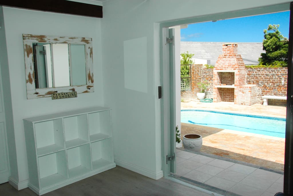 shoe stand along with rustic mirror with beautiful view of pool and bbq