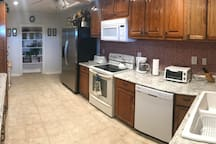 Kitchen - fully equipped - Refrigerator, Dishwasher, microwave, stove and plenty of cabinet space.