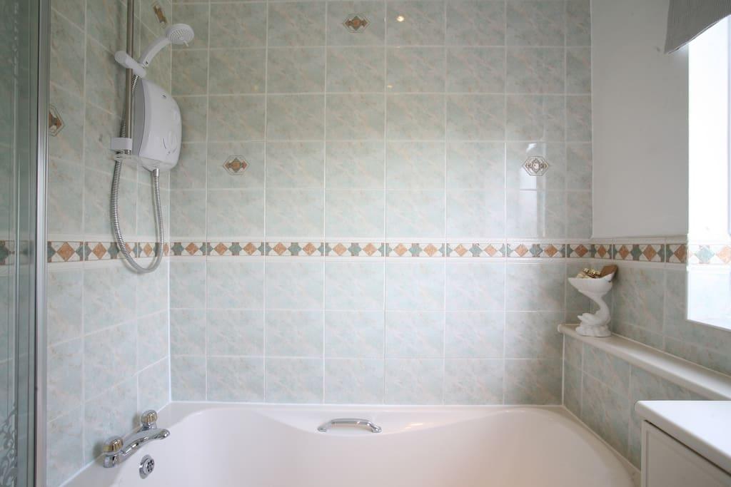 En-suite bathroom with toilet, towel rail and basin