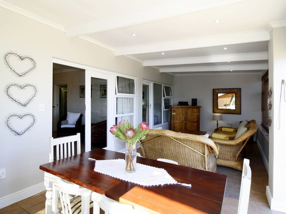 The open plan living area has a stack door opening up to the private garden and the beautiful views