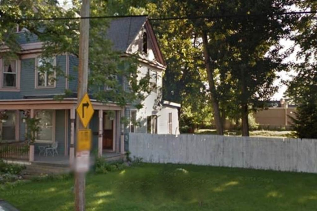 Quaint Victorian Cottage with large fenced in yard and off street parking.