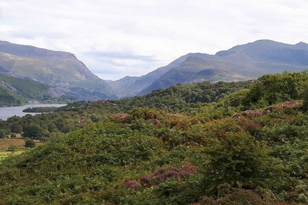 The view from top of the hill overlooking Llyn Padarn and Snowdon (far right peak).