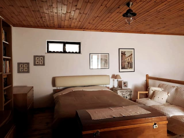 Double bed in the loft of the Villa