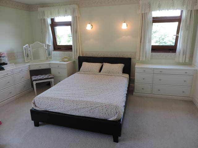 Large ensuite bedroom with stunning views