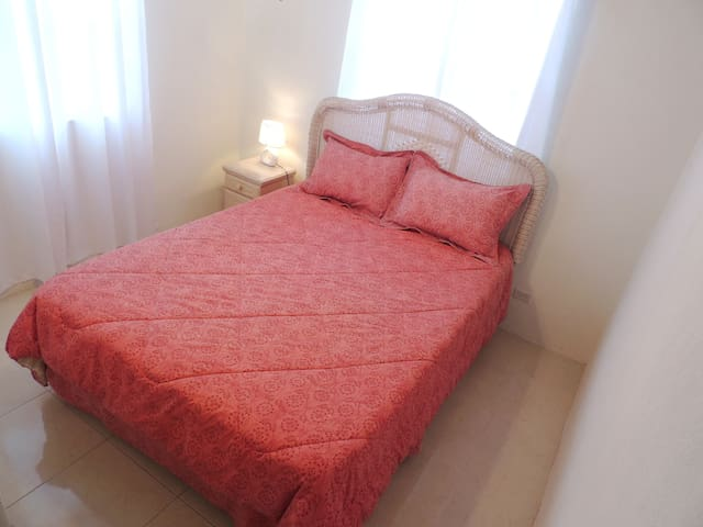 (1st) Bedroom located on the right as you enter the apartment - Queen sized bed, A/C, ceiling fan, built in closet, side table & lamp.