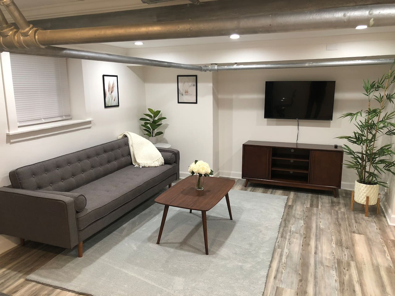 lovely mid century modern style living room with 4k smart tv for all your favorite streaming apps