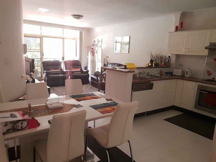 Sunny spacious Living-room and kitchen with a leafy outlook to the balcony