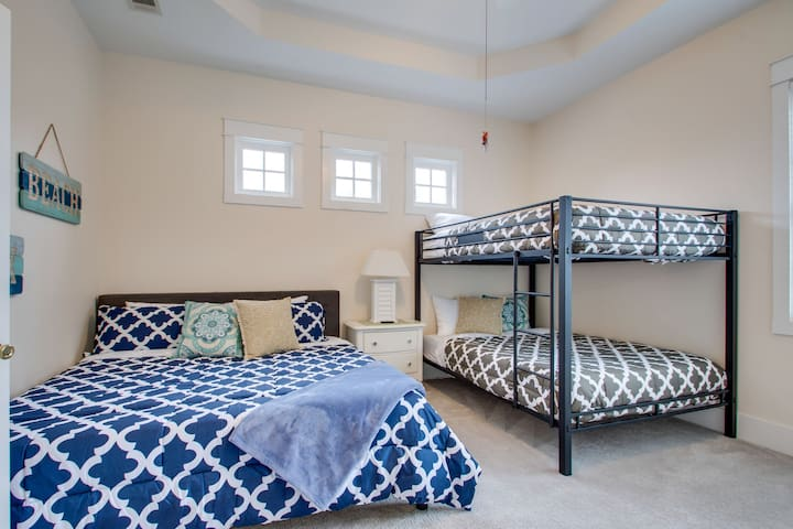 Our secondary Master Bedroom on the second floor with King (blue) and Queen over Queen (gray) that can fit the whole family with attached bathroom with shower and jacuzzi bathtub.