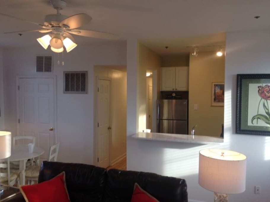 Kitchen open to living area with convenient snack bar
