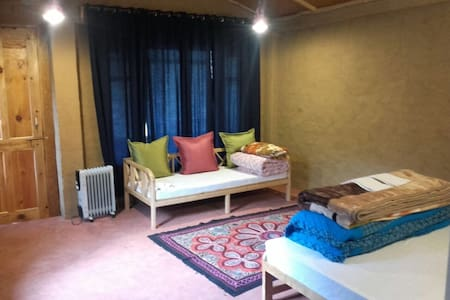 Cozy rooms done up by Himachali artisans promise the best of both worlds - homely comfort and tourist-y charm!