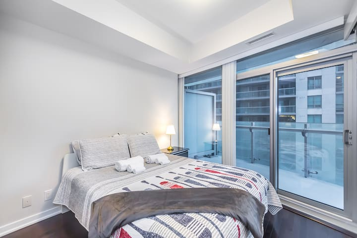 Stunning Bedroom by CN Tower Best Value For Money
