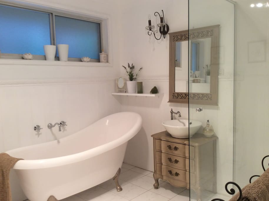 Bathroom with shower toilet vanity and ornamental bath