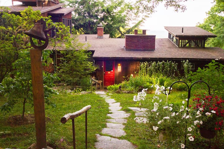 Path from parking place to front door of main cottage. Eagles entrance stairway to left of red door.