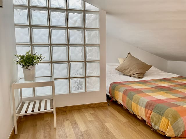 Mezzanine bedroom with a comfortable double bed is perfect for kids or another couple