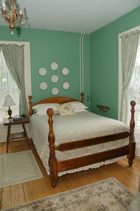 Queen bedroom with private three piece ensuite. Two large windows. Desk area and chair. Free wifi in room and thought the house. There are multiple common areas in the house nearby with flat screen cable television.