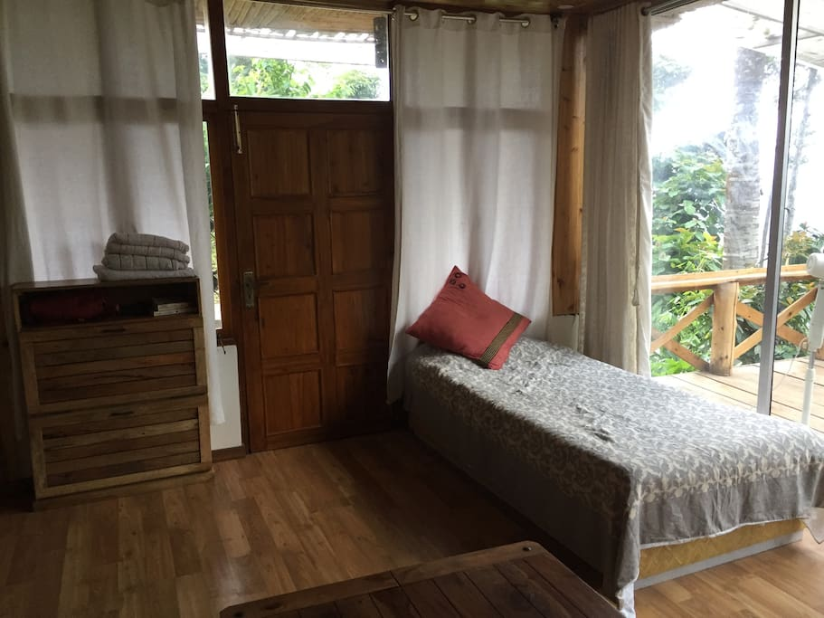 Single bed next to the deck