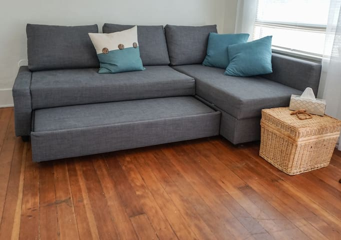 Easy to pull out futon sofa makes into a queen bed, leaving plenty of room for a floor mattress.