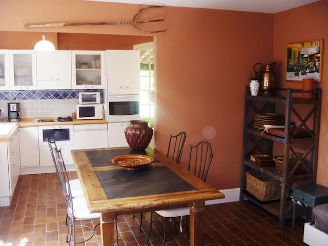 Eat-in kitchen with all appliances And access to outdoor terrace
