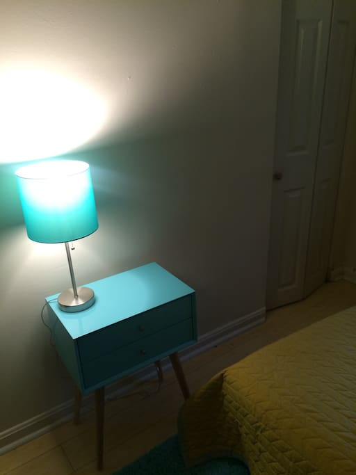 Lamp, nightstand and closet.