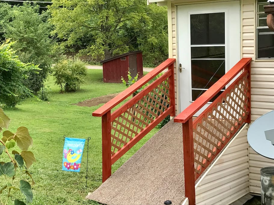 Entrance ramp to The Birdhouse enclosed porch and apartment entry.