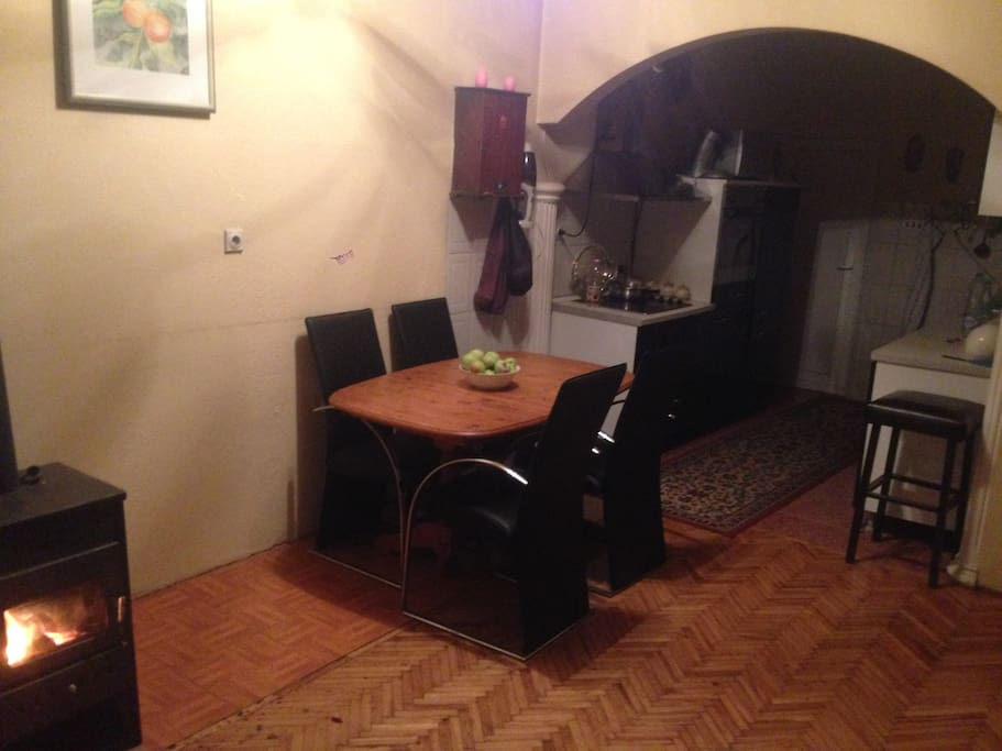Another part of the Kitchen and the eating table with 4 amazing seats.