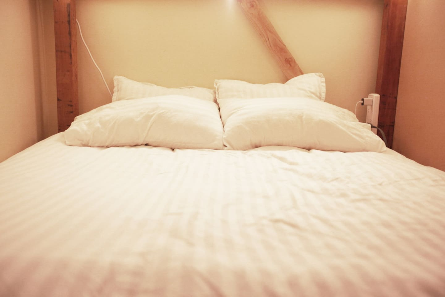 Your queen size bed has an incredibly comfortable mattress and luxury linens.