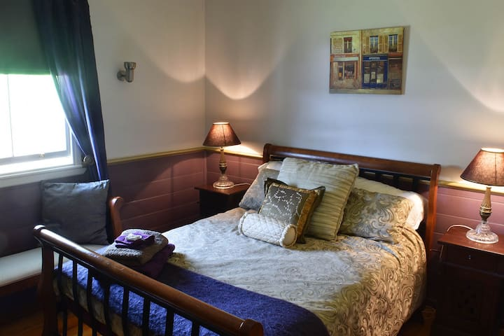 Master's Bedroom, with garden views. Queen size bed with luxury bed linen and towels provided