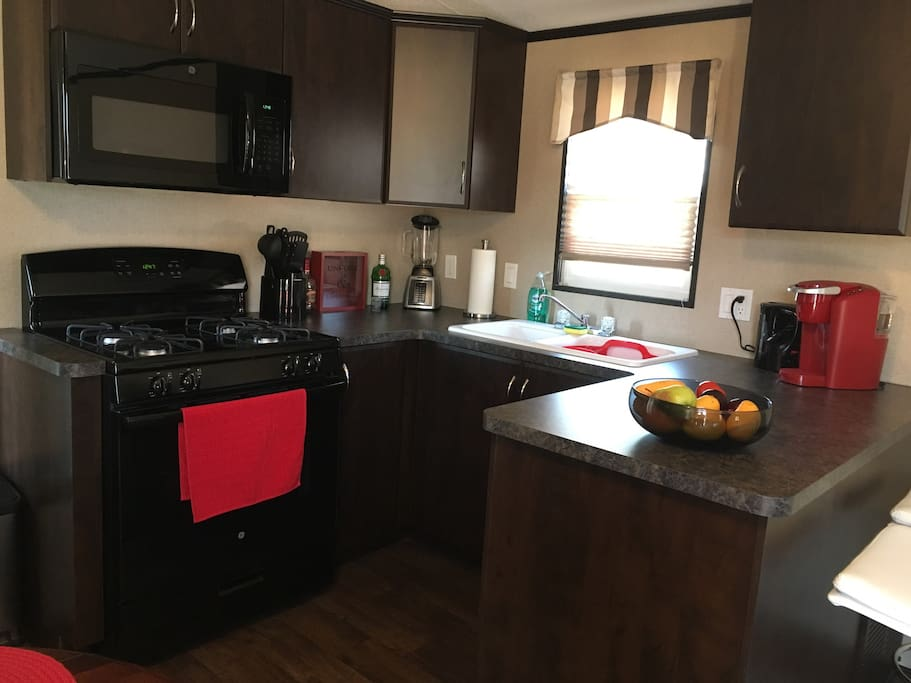 Fully equipped kitchen, full size propane oven. Kitchen has two bar stools for additional seating