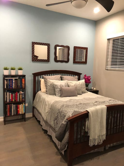 Comfortable queen bed with fresh linens.