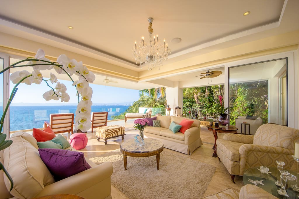 Formal living room surrounded by Ocean and Jungle