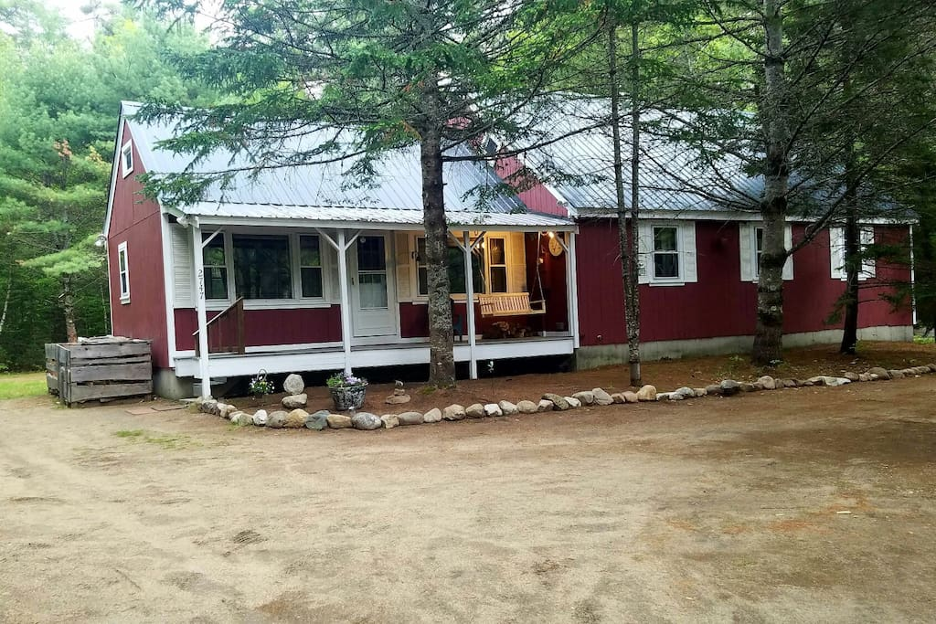 Rocks, decor, and porch swing are all new!