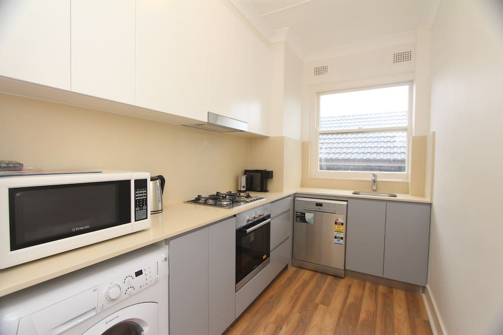 Brand new gas kitchen, microwave, coffee machine and dishwasher