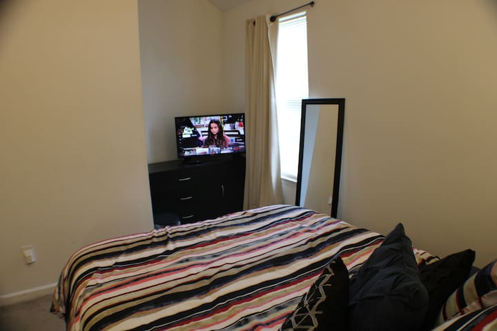 Private room, full bed, desk, TV, fridge