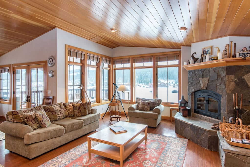 Enjoy serene pond views from the rustic-chic living room.