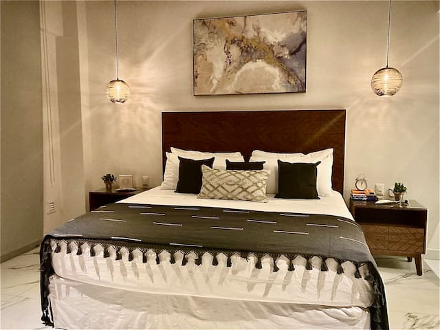Comfortable King size bed with posturpedic mattress