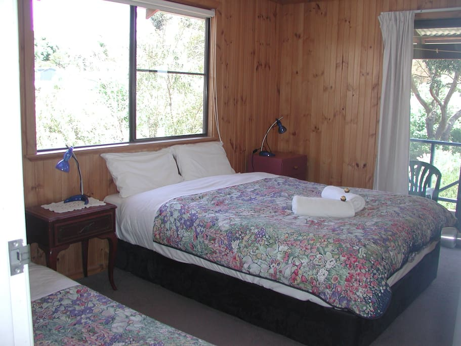 Private bedroom, with queen and single bed.