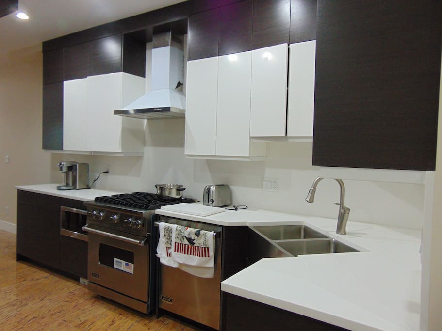 Kitchen Area. Include Toaster, Kettle, Coffee Maker.  Cooking and Dining Utilities