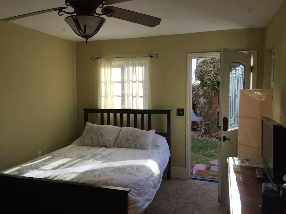 The guest suite door opens into a beautiful corner of the garden.