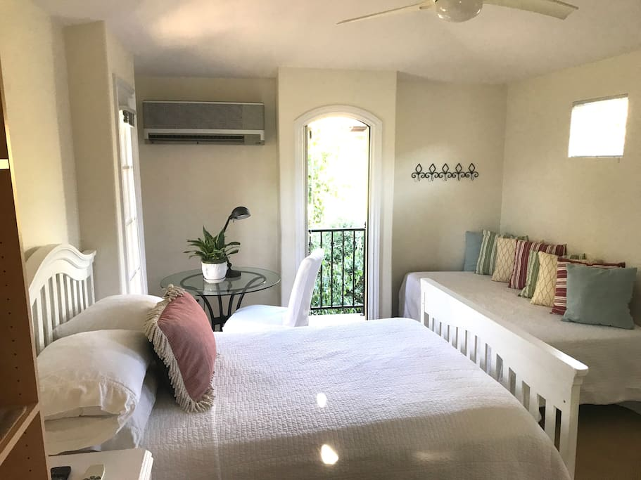 Clean, bright and airy bedroom with 1 double bed, 1 twin bed a small table for reading or having cup of coffee.