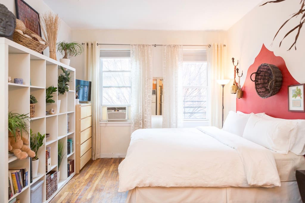 Great photo books and lots of linens and pillows fill the apartment