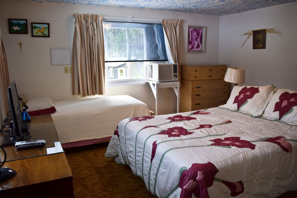 Room 1 with one queen bed and one twin bed