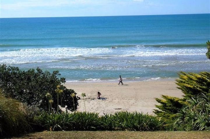Beachfront. On the sand: Wainui