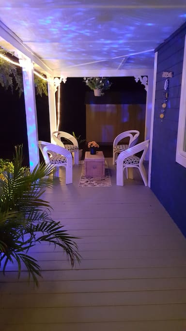 Seating area at the end of the porch and deck