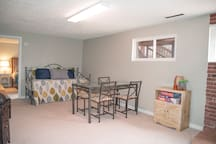 Basement family room with daybed and trundle.
