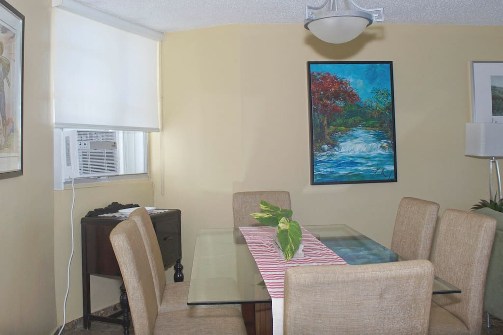 Window unit powerful enough to cool dining area.