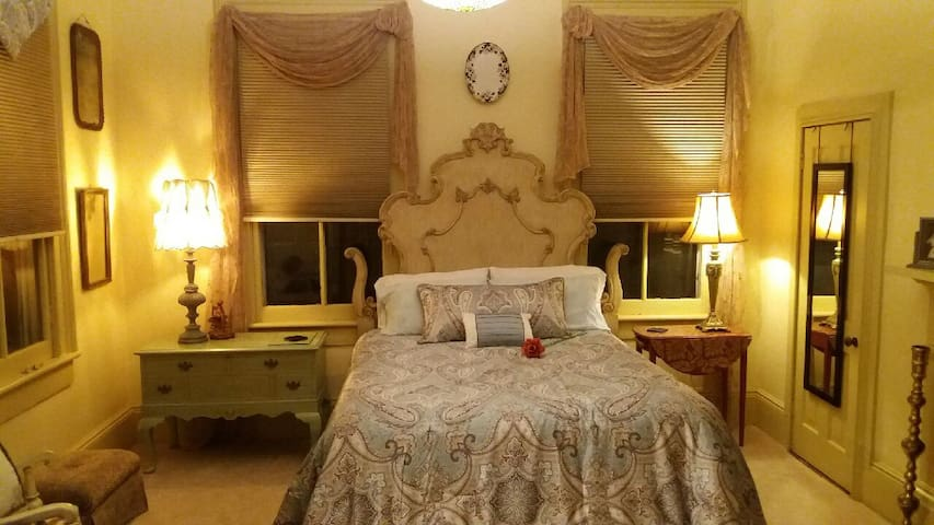 Beautiful French Victorian-inspired headboard frame and furnishings welcome you to the Annabelle Suite.