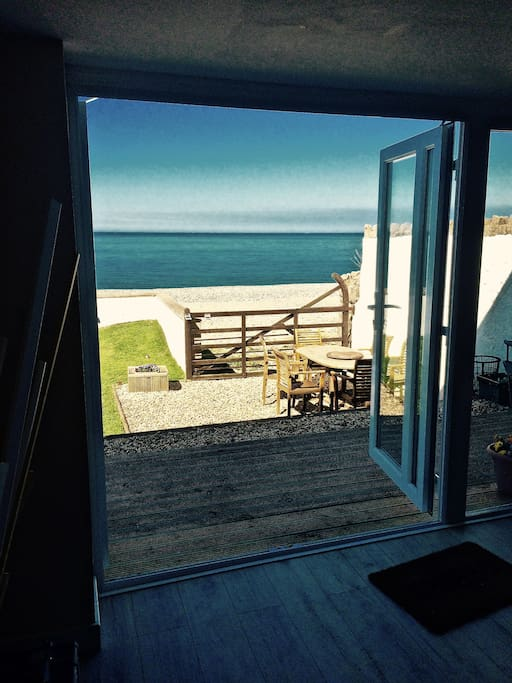 Open up your French Doors & let the Garden & the Beach into your Lounge Area