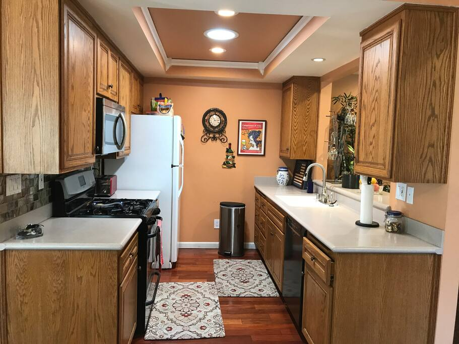 The kitchen is compact, but open the the living room and dining areas and is fully stocked.